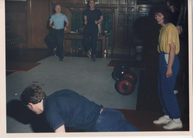 A young fireman yates giving a demonstration of what happens in the gym session