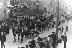 Firemen Riding In Parade Circa 1900's