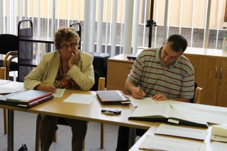 Dot and Pete taking notes on the cataloguing and digitising course