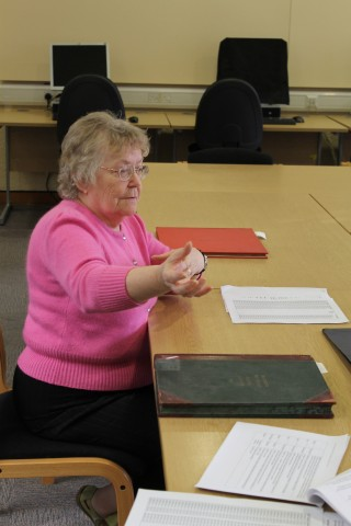 Pauline looking at the log books  and how to make use of them