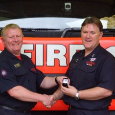 Pete Fraser receives his  25 years service award from Pete Turner