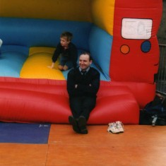 Bill Taylor doing his bit looking after the bouncy castle