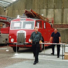 Bob France setting up the old escape ladder for viewing with Stuart Padbury in front