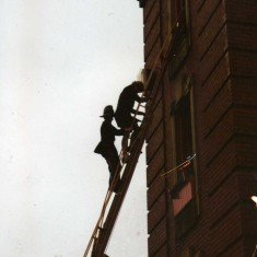 helping the damsel down the ladder