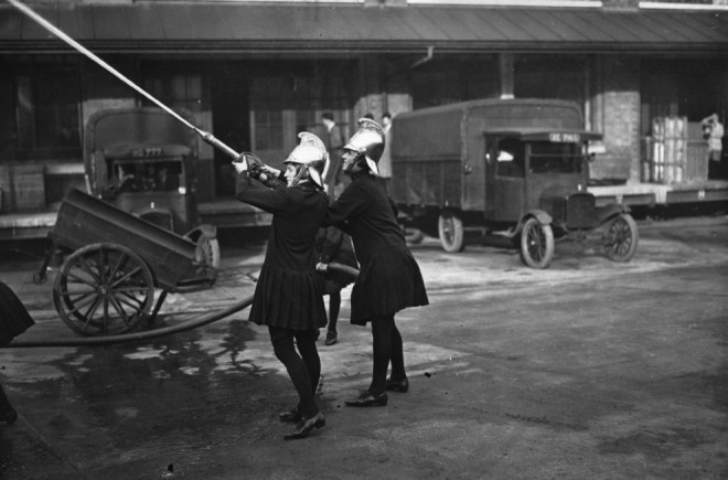 1928, Two firefighters during a drill