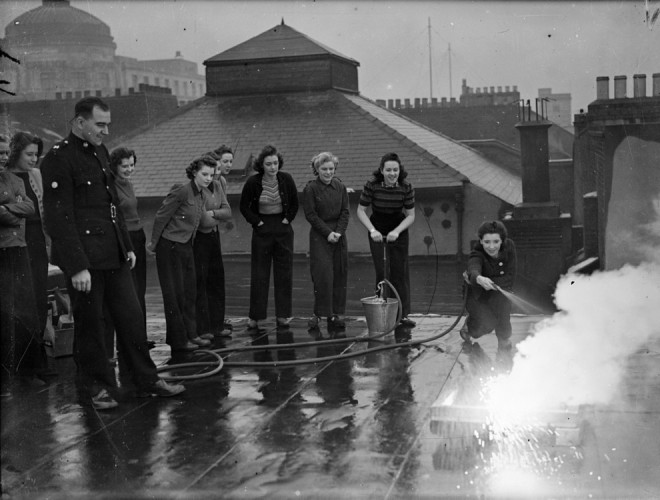 "1941, chorus girls respond to the call for volunteer ""fire watchers"" are trained by the Newcastle Fire Brigade."