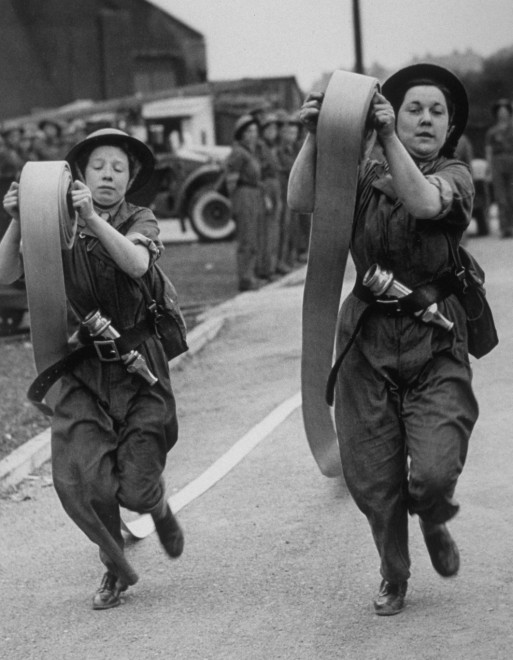 1942, Female firefighters during a skills demonstration.