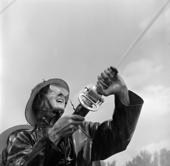 1950, A competitor at the Minneapolis Auxiliary Fire Crews Competition in Minnesota.