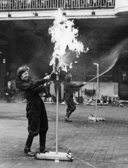 1961, Margaret Scaife and Marjorie Barrrow compete in the British Railways Inter-Regional Fire Fighting